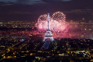 The Eiffel Tower is illuminated during the traditional Bastille Day fireworks display
